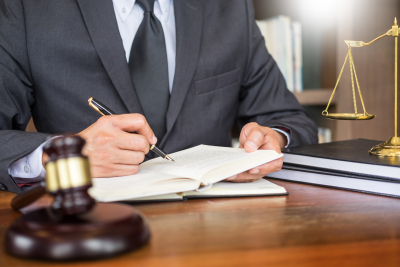 lawyer writing a document