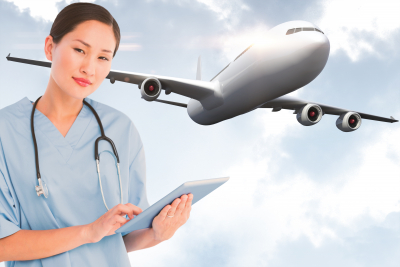 nurse using a digital tablet and an airplane in the background